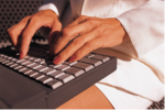 woman's hands typing on laptop